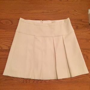 Cream pleated mini skirt